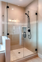 Shower Stall With Half Glass Enclosure And Black Shower Head And Handle