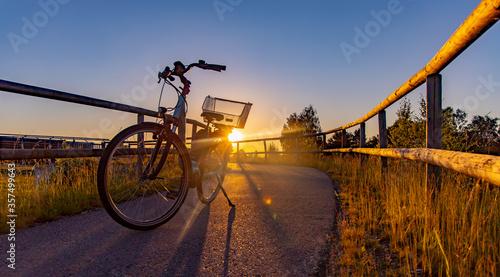 Obraz na plátně Fahrrad, Bike Tour bei Sonnenuntergang