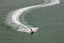 Red Jetski Moving Very Fast Le...