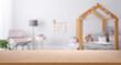 Leinwanddruck Bild - Empty wooden table in baby room interior