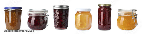 Fotografija Set of jars with delicious jams on white background