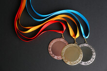 Gold, Silver And Bronze Medals On Black Background, Flat Lay. Space For Design