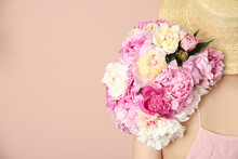 Woman With Bouquet Of Beautifu...