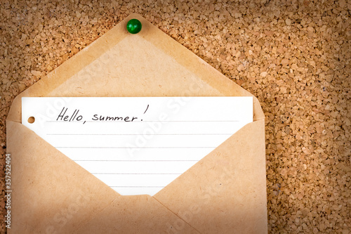 """Fotografie, Tablou """"Hello Summer,"""" written on lined paper - a letter in an envelope attached to a c"""