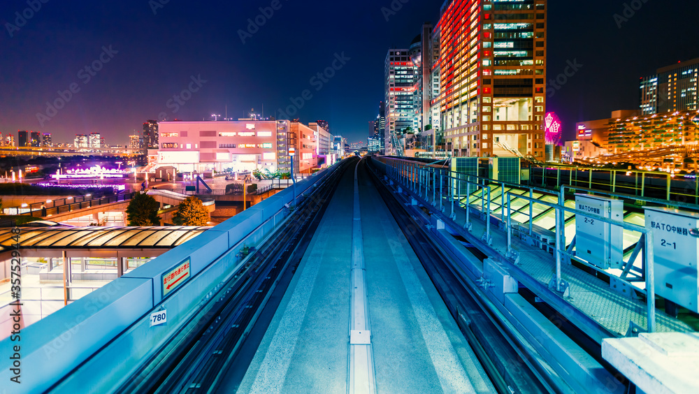 Fototapeta Abstract high speed technology POV train motion blurred concept from the Yuikamome monorail in Tokyo, Japan