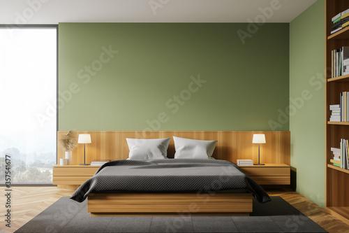 Green master bedroom interior with bookcase Fototapeta