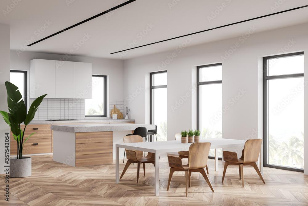 Fototapeta White kitchen corner with bar and table