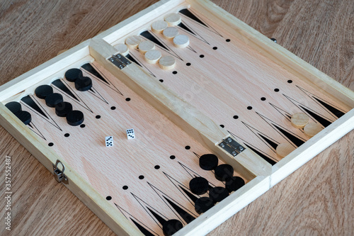 Backgammon Board Game. Wooden backgammon board Fotobehang