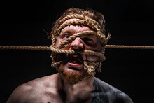Photo Of Binded Bearded Man With Rope On Face