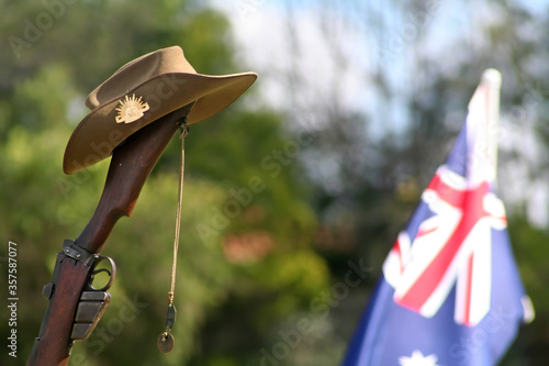 Canvas Print Horizontal (landscape) closeup portrait of upturned Australian 303 rifle fitted with a bayonet, Australian Slouch Hat, dogtags and Australian Flag on ANZAC Day on the Gold Coast in Queensland,