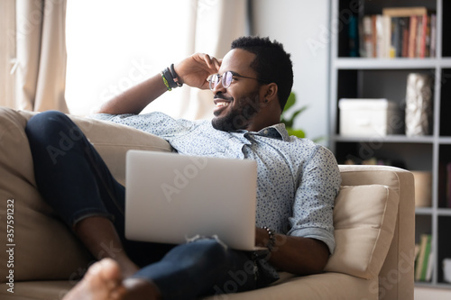 Fotografía Single guy resting on couch with pc, internet user distracted from laptop usage