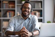 African Man Wear Headset Sit A...