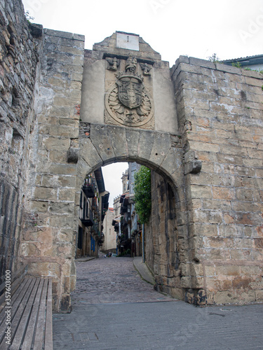 Santa Maria gate, one of the two entrance doors to the city, above it is the coat of arms of Hondarribia and a clock, Hondarribia, Guipúzcoa, Spain