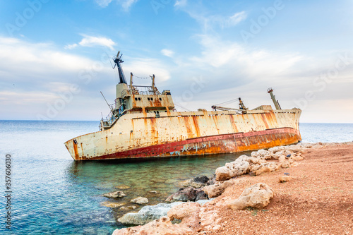 Abandoned rusty ship stranded ashore nearby Peyia village, Paphos, Cyprus Canvas Print