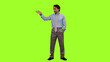 Leinwandbild Motiv Front view Business coach standing in front of audience on green screen background, Chroma key