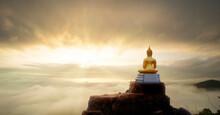 Gold Buddha Statue Meditation On Criff With Sunlight