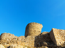 The Crumbling Ruins Of The Old Fort On The Top Of Crimean Mountains In The Bright Sunlight Contrast Against The Background Of Contrasting Shade. Crimea, Balaklava.