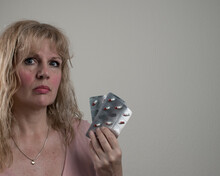 Woman Holding Medication