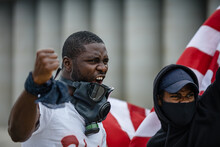 Portrait Of Two Men Protesting