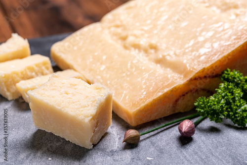 Big wedge of parmigiano-reggiano parmesan hard Italian cheese made from cow milk Fototapeta