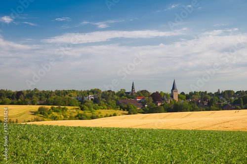 Foto the two churches called Wiesnasen of Ratingen Homberg at summer