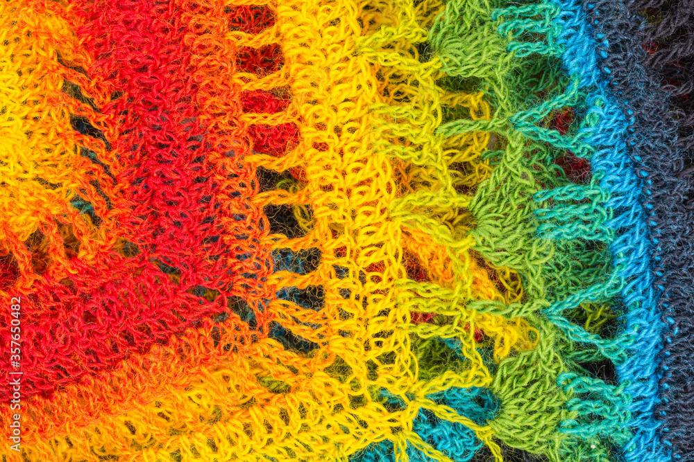 handmade multicolor crochet background with double crochet stitches, triple crochet stitches and chain stiches