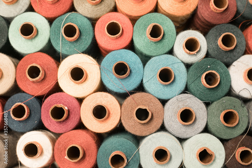 Valokuvatapetti Threads in a tailor textile fabric: colorful cotton threads, birds eye perspecti
