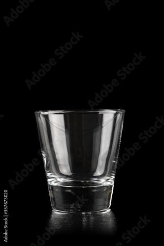 Fototapeta Glass for alcoholic drinks on black obraz na płótnie
