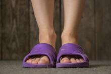 Female Legs In Rubber Slippers...