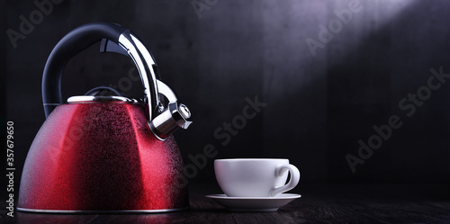 Fototapeta Red stainless steel stovetop kettle with whistle obraz