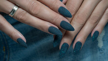 Blue Manicure With A Glitter. ...