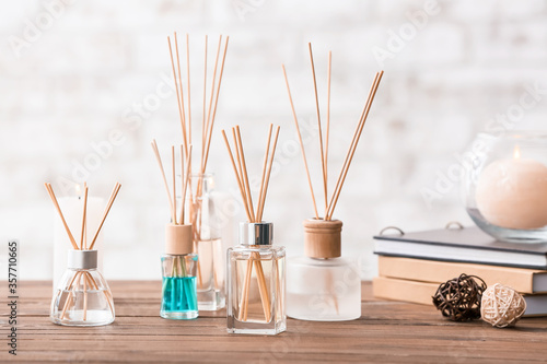 Reed diffusers on table in room Fototapet