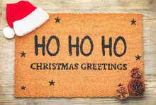 Door Mat With Christmas Decor On Wooden Background