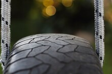 Closeup Shot Of A Tire Swing On A Blurred Background