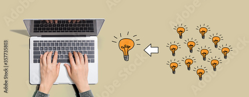 Many small ideas into one big idea with person using a laptop computer