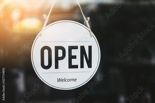 Open sign broad hanging on wood door front of cafe. Tablou Canvas