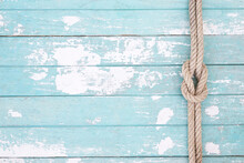Pattern Rope On A Blue Old Wooden Background. Top View. Leave A Copy Space For Writing Descriptive Text. Tone Colorful Pastel.
