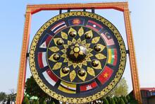 The Biggest EAC Gong, Thai Called Khong At Wat Tham Khuha Sawan, Khong Chiam, Ubon Ratchathani Province, Thailand. People Visit And Respect Praying Buddha Statue.