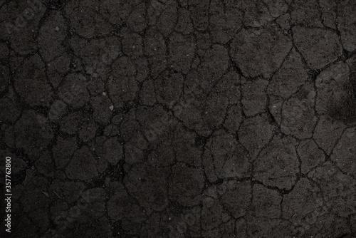 Leinwand Poster Black cracked soil texture background