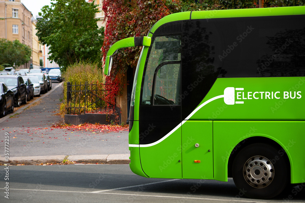 Fototapeta Electric tourist bus on a city street