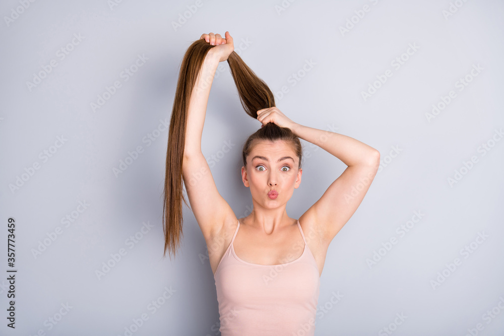 Fototapeta Close-up portrait of her she nice-looking attractive lovely pretty cheerful funky brown-haired girlfriend making ponytail sending air kiss isolated on light gray pastel color background