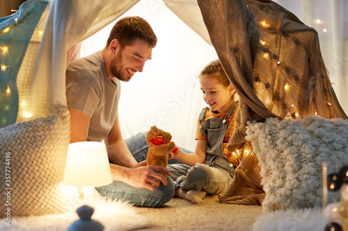 Fotografie, Obraz family, hygge and people concept - happy father with teddy bear toy and little d