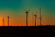 Wind Turbines With Orange Gree...