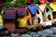 Colorful Wooden Birdhouses In A Park
