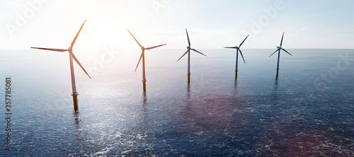 Obraz Offshore wind turbines farm on the ocean. Sustainable energy - fototapety do salonu