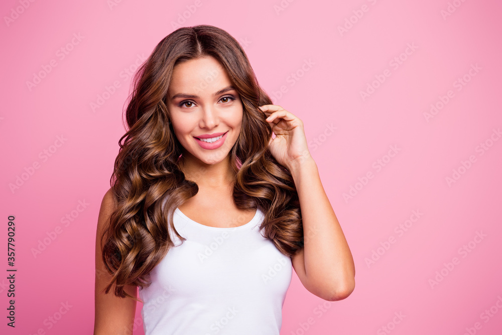 Fototapeta Close-up portrait of her she nice-looking attractive lovely lovable pretty cute winsome gorgeous cheerful cheery wavy-haired girl touching curls isolated over pink pastel color background