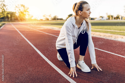 athlete in sportswear, on the starting line in the race Fototapeta