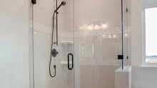 Panorama Bathroom Shower Stall With Half Glass Enclosure Adjacent To Built In Bathtub
