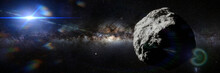 Asteroid In Empty Space Lit By...