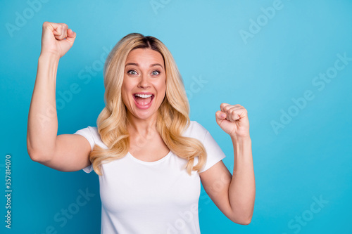 Obraz na plátně Portrait of ecstatic crazy woman enjoy rejoice incredible lottery win raise fist